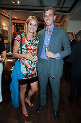 SARAH FORTESCUE and EDWARD WATT at a reception in aid of Save The Elephants held at Patrick Mavros, 104-106 Fulham Road, Lodon SW3 on 23rd September 2009.