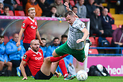 Kieran Green of Blyth Spartans (4) is fouled by Russell Penn of York City (6) during the Vanarama National League match between York City and Blyth Spartans at Bootham Crescent, York, England on 27 August 2018.