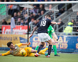 Morton&rsquo;s Ricki Lamie tackles Falkirk&rsquo;s Lee Miller. <br /> half time : Falkirk 0 v 0 Morton, Scottish Championship game  played 1/5/2016 at The Falkirk Stadium.