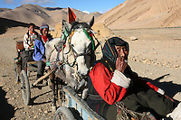 A Tibetan family travels the remote road in route to Mt. Everest, part of the Himalayan mountain range, in Tibet, in western China. (Photo/Scott Dalton)
