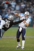 OAKLAND, CA - DECEMBER 19:  Quarterback Billy Volek #7 of the Tennessee Titans gets hit by Bobby Hamilton #98 of the Oakland Raiders on a key 3rd down play late in the game. Volek had the second best passing day in franchise history, completing 40 of 60 passes for 492 yards and 4 touchdown passes, while also running for another touchdown against the Oakland Raiders at Network Associates Coliseum on December 19, 2004 in Oakland, California. The Raiders defeated the Titans 40-35. ©Paul Anthony Spinelli *** Local Caption *** Billy Volek;Bobby Hamilton