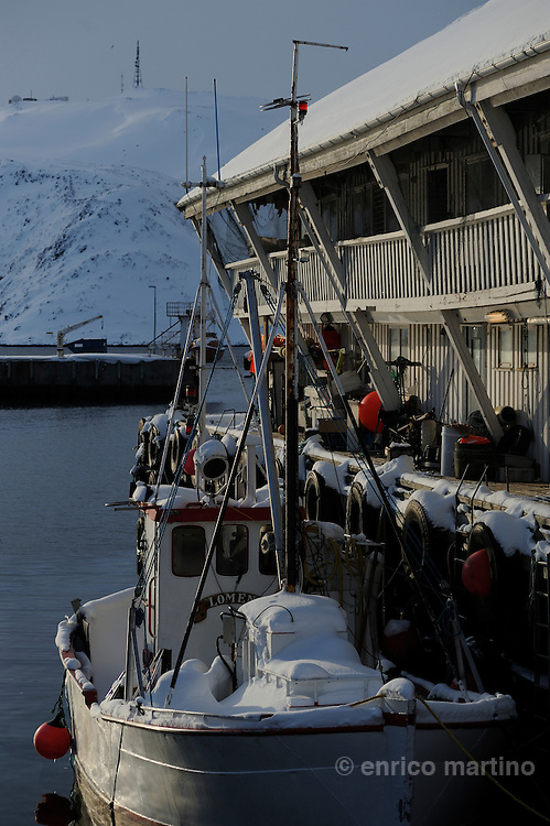 Honningsvåg, the harbour. The ice-free ocean, southwestern part of the Barents Sea, provides rich fisheries even today. Honningsvag, at 70° 58' North in Nordkapp municipality claims to be the northernmost city in Norway and even in the world, although the title is disputed by Hammerfest, Norway; Barrow, Alaska and Longyearbyen, Svalbard. Legislation effective from 1997 states that a Norwegian city must have 5,000 inhabitants, but Honningsvåg with its population of 2367 was declared a city in 1996, thus exempt from this legislation. It is situated at a bay on the southern side of Magerøya island, while the famous North Cape and its visitors center is on the northern side.