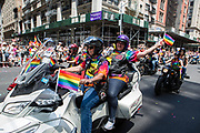 New York, NY - 30 June 2019. The New York City Heritage of Pride March filled Fifth Avenue for hours with participants from the LGBTQ community and it's supporters. Motorcycles led the march, including these two women.