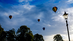 Strathaven Scotland UK 27th August 2016 - The Strathaven Balloon Festival is an annual event and the only one of its kind in Scotland held in 2016 from 26th - 28th August. The first flights of the festival took place at dawn on Saturday 27th August <br /> <br /> Balloons over Strathaven just after dawn.<br /> <br /> (c) Andrew Wilson | Edinburgh Elite media