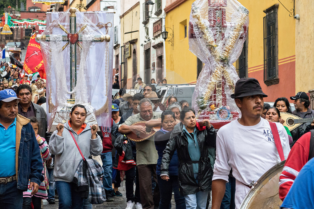Residents carry crosses and religious icons in a procession through the historic city during the week long fiesta of the patron saint Saint Michael September 24, 2017 in San Miguel de Allende, Mexico.