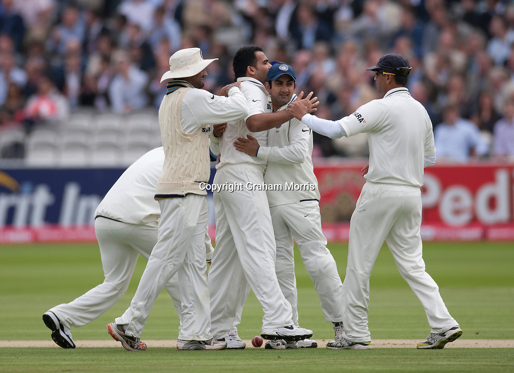 Celebrations as Alastair Cook is out lbw to Zaheer Khan during the first npower Test Match between England and India at Lord's Cricket Ground, London.  Photo: Graham Morris (Tel: +44(0)20 8969 4192 Email: sales@cricketpix.com) 21/07/11
