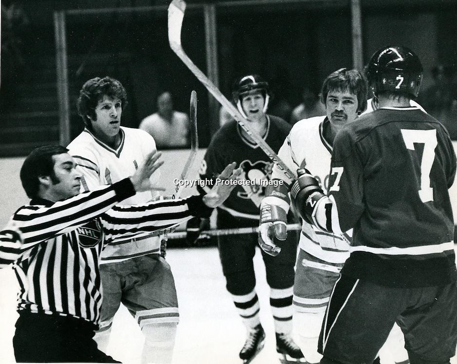 Seals action, Gary Sabourin and Bob Stewart ready to .mix it up with Jean Pronovost and Steve Durbano..(1976 photo by Ron Riesterer)