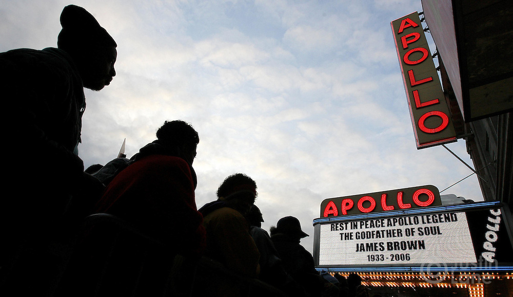 A group of people wait in line to see the late James Brown lying in repose at the Apollo Theater in the Harlem neighborhood of New York, New York on Thursday 28 December 2006. Music legend Brown, who died at the age of 73 earlier this week, is being honored with ceremonies in New York and Georgia over the next few days.