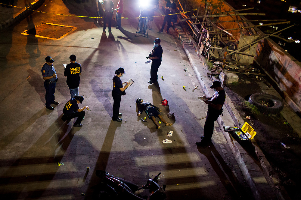 Crime Scene Investigators inspect a dead body at a crime scene in Mueller Del Rio.  It was reported that the man resisted arrest and fought back.  A gun is found within his reach. <br /> <br /> Over 12 thousand people including men, women and even young teens who are mostly the urban poor, have been killed since President Duterte initiated the campaign against drugs. The killings or executions are carried out by masked gunmen. Bodies in morgue showed signs that the victims were bound or handcuffed but the police report often states they fought back or tried to run away.