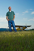 Patrick Carter, president of NFlightcam, stands next to a plane in Fayetteville, Arkansas.