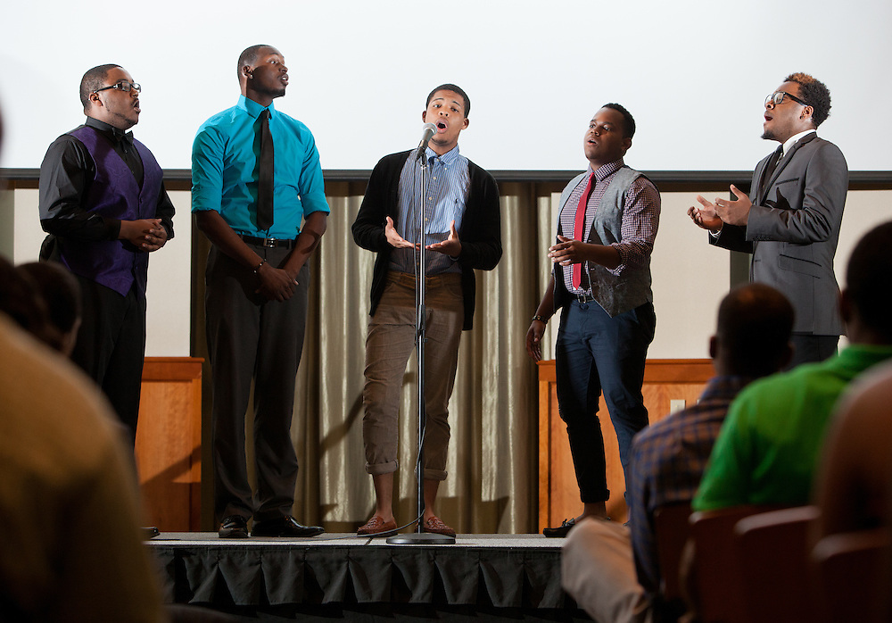 From left: Richard Moses, Julius Smiley, Lorne Owens, Kari M. Curry, and Jeffrey Billingslea give a vocal performance during the first-ever Men of Black Excellence Awards at Ohio Univesity, held on April 13, 2014, in Walter Rotunda. The ceremony recognized African American students in categories such as academics, campus involvement, and the performing arts, among others, and featured keynote speaker Aaron Jeter. Photo by Lauren Pond
