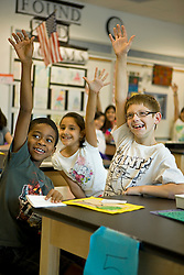 Stock photo of students answering questions in class at Lovett Elementary School in Houston Texas