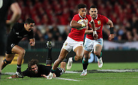 Rugby Union - 2017 British & Irish Lions Tour of New Zealand - First Test: New Zealand vs. British & Irish Lions<br /> <br /> Anthony Watson of The British and Irish Lions escapes the tackle of Sam Whitelock of The All Blacks at Eden Park, Auckland.<br /> <br /> COLORSPORT/LYNNE CAMERON