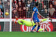 Bolton Wanderers goalkeeper Ben Alnwick (1) dives and makes a save during the EFL Sky Bet Championship match between Brentford and Bolton Wanderers at Griffin Park, London, England on 22 December 2018.