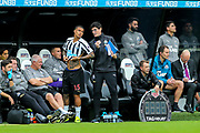 Kenedy (#15) of Newcastle United receives instructions as he prepares to enter the match during the Premier League match between Newcastle United and Arsenal at St. James's Park, Newcastle, England on 15 September 2018.