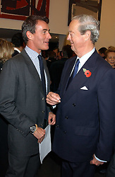 Left to right, TIM JEFFERIES and the DUKE OF MARLBOROUGH at a private view of paintings by Rosita Marlborough (The Duchess of Marlborough) held at Hamiltons gallery, Carlos Place, London W1 on 9th November 2005.<br />