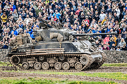"An M4A2(76) HVSS Sherman tank, drives around the tank course at the Tank Museum in Bovington, Dorset, as the attraction hosts ""Tiger Day"" to mark the 75th anniversary of the world's only working Tiger Tank's capture in 1943 in the Tunisian desert."