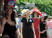 Contestants line up to enter the Longines Most Elegant Woman at Belmont fashion contest, Saturday, June 7, 2014, at Belmont Park in New York.  Longines, the Swiss watchmaker known for its elegant timepieces, is the Official Watch and Timekeeper of the 146th running of the Belmont Stakes. (Photo by Diane Bondareff/Invision for Longines/AP Images)