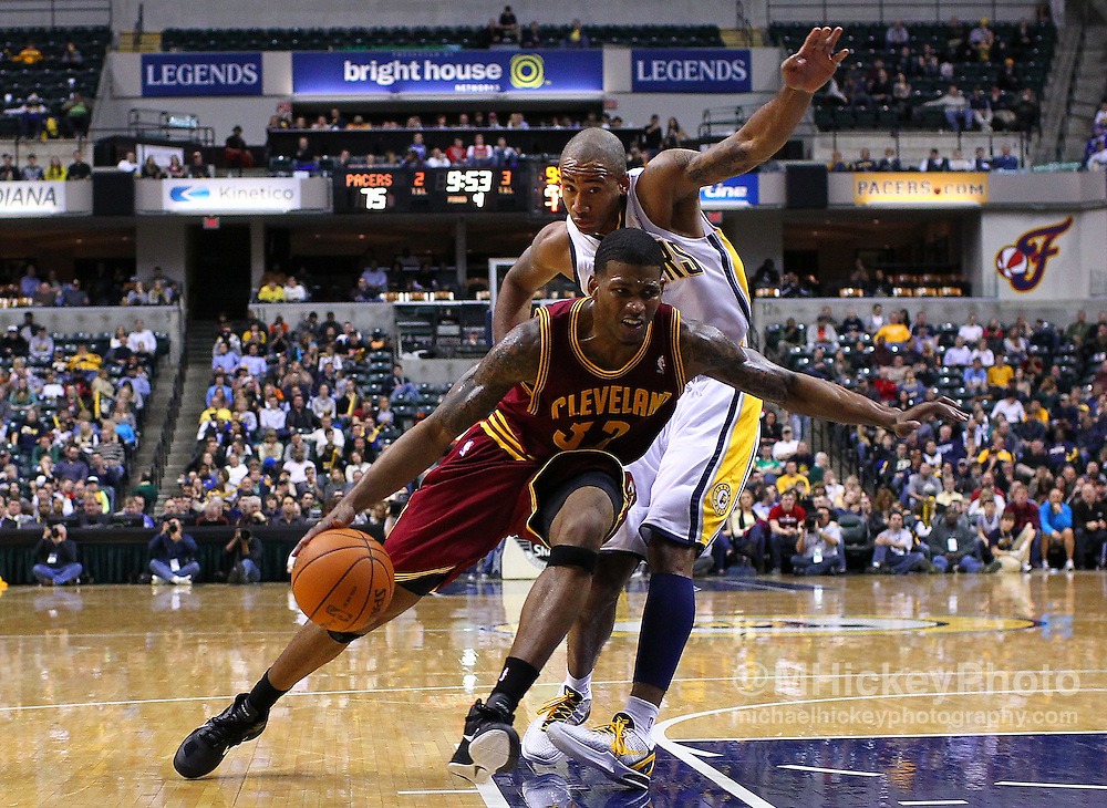 Dec. 30, 2011; Indianapolis, IN, USA; Cleveland Cavaliers shooting guard Alonzo Gee (33) dribbles to the basket as Indiana Pacers shooting guard Dahntay Jones (1) defends from behind at Bankers Life Fieldshouse. Indiana defeated Cleveland 81-91. Mandatory credit: Michael Hickey-US PRESSWIRE