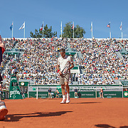 PARIS, FRANCE May 31. Rafael Nadal of Spain is given his towel by a ball boy between points during his match match against David Goffin of Belgium during the Men's Singles third round match on Court Philippe-Chatrier at the 2019 French Open Tennis Tournament at Roland Garros on May 31st 2019 in Paris, France. (Photo by Tim Clayton/Corbis via Getty Images)