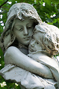 Grieving young mother with child statue Novodevichy Cemetery, Moscow, Russia