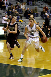 16 December 2006: Anthony Gunnell heads up the lane on a fast break paralleled by Drew Adams. The University of Chicago Maroons upset  the Illinois Wesleyan Titans 64 - 60 at the Shirk Center in Bloomington Illinois.<br />