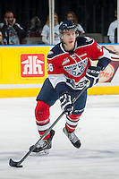 KELOWNA, CANADA - MARCH 28: Brandon Carlo #36 of the Tri-City Americans skates with the puck against the Kelowna Rockets on March 28, 2014 during game 5 of the first round of WHL Playoffs at Prospera Place in Kelowna, British Columbia, Canada.   (Photo by Marissa Baecker/Getty Images)  *** Local Caption *** Brandon Carlo;