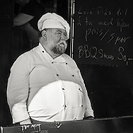 Norwegian chef serving BBQ and sausage at a festival in Trondheim Norway