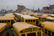 A fleet of buses parked in the bus yard at Coney Island on a December afternoon
