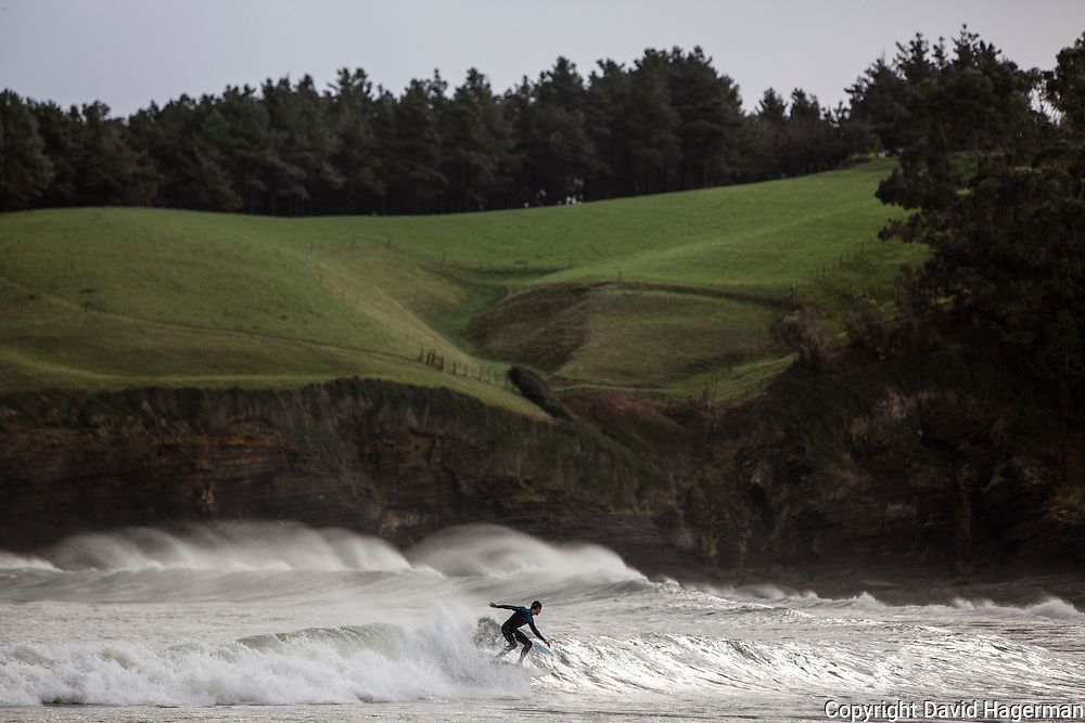 Surfers take to the waves in Letikeo, Spain