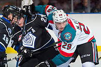 KELOWNA, CANADA - SEPTEMBER 2: Left wing Nolan Foote #29 of the Kelowna Rockets checks right wing Jared Dmytriw #27 of the Victoria Royals on September 2, 2017 at Prospera Place in Kelowna, British Columbia, Canada.  (Photo by Marissa Baecker/Shoot the Breeze)  *** Local Caption ***