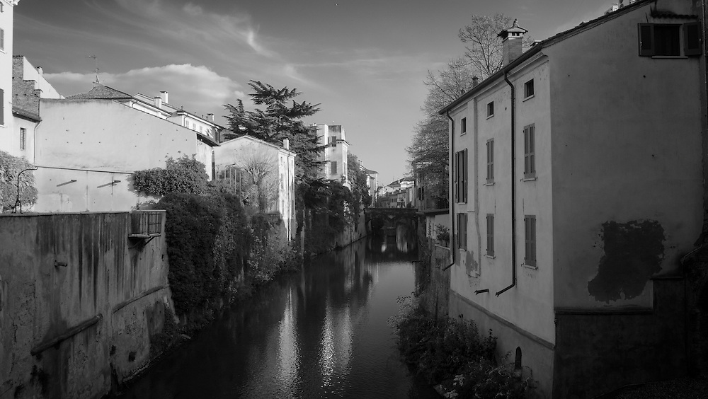 Rio Canal, Mantua, Italy. A series of captures from a personal trip to the cities of Milan and Mantua, featuring explorations of Renaissance architecture and the vibrant life of Italian streets.