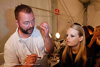 Backstage at Michael Kors - makeup artist Dick Page working during Mercede's Benz Fashion Week Spring 2010 on September 13, 2009. ..