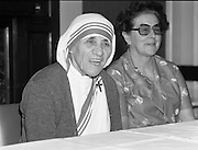 Mother Teresa of Calcutta speaks at press conference  organised by SPUC (Society for the Protection of Unborn Children)..1982-08-02.2nd August 1982.2/08/1982.08-02-82..Pictured at Wynns Hotel, Dublin..From Left:..Mother Teresa.Menia Aitken, Development Officer for SPUC, Ireland.<br />