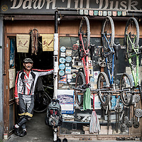 Sonam Gurung, the grandfather of mountain biking in Nepal, pictured at his shop in Kathmandu in 2015.