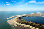 Nederland, Zuid-Holland, Rotterdam, 18-02-2015; zicht op De Slufter vanaf de Brielse Gat, Tweede Maasvlakte (MV2) in het verschiet. De Slufter is een grootschalige opslagplaats voor vervuild havenslib. De verontreinigde baggerspecie komt voort uit het onderhoudsbaggerwerk in de Rotterdamse haven waarbij de haven op diepte wordt gehouden. Op de Tweede Maasvlakte wordt gewerkt aan de inrichting van de haventerreinen.<br /> The Slufter area in the South-West of the Netherlands, large-scale depot of contaminated harbor sludge from the Port of Rotterdam. Along the edge of the Slufter windmills are built. The Second Maasvlakte with new harbours in the background<br /> luchtfoto (toeslag op standard tarieven);<br /> aerial photo (additional fee required);<br /> copyright foto/photo Siebe Swart