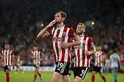Richard Stearman of Sheffield United Celebrates scoring a goal during the EFL Cup match between Sheffield United and Blackburn Rovers at Bramall Lane, Sheffield, England on 27 August 2019.