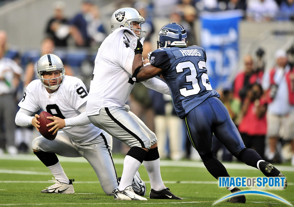 Aug 29, 2008; Seattle, WA, USA; Oakland Raiders kicker Sebastian Janikowski (11) blocks Seattle Seattle Seahawks cornerback Kevin Hobbs (32) as Raiders punter Shane Lechler (9) fields a bobbled snap on a field-goal attempt at Qwest Field. The Seahawks defeated the Raiders 23-16.