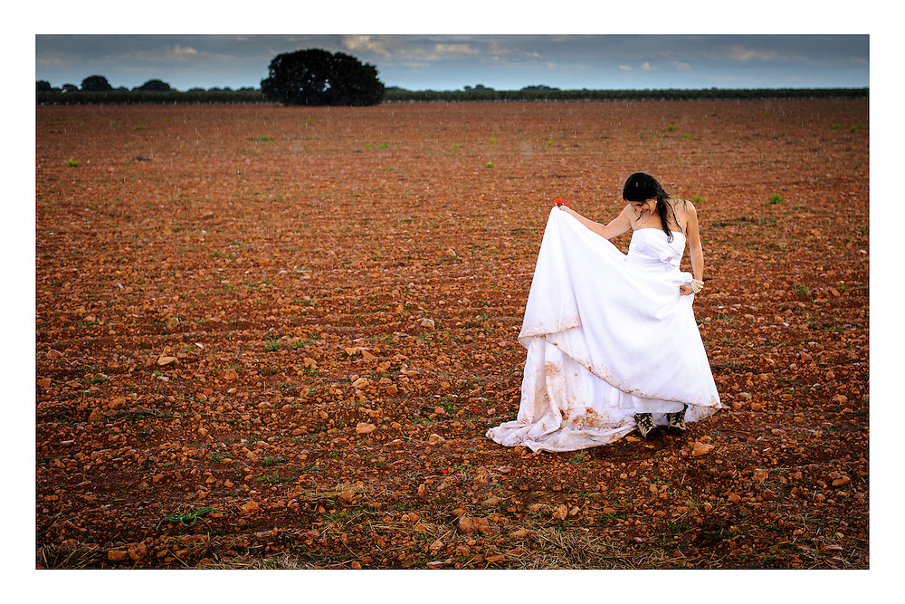 Decided to go into the fields and trash the dress after the wedding in Spain. It started raining at the perfect time. http://www.kouroshazar.com