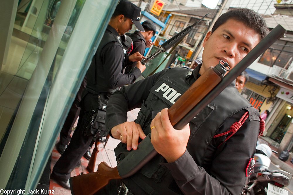 "May 12 - BANGKOK, THAILAND: Thai security personnel load and check their weapons before going on duty near the front line of the Red Shirt protesters and security forces in Sala Daeng intersection Wednesday. The Thai government said Wednesday that time has run out for ""Red Shirt"" protesters in Ratchaprasong and Sala Daeng intersections in Bangkok and that a crackdown could come at any time. As news of the anticipated crackdown spread, Red Shirt protesters continued with an almost festive mood at their main stage but many of the sleeping areas around the protest site appeared to be empty. No official estimates on crowd size are available.  Photo by Jack Kurtz"