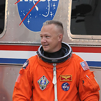 The space shuttle Atlantis pilot Doug Hurley smiles to the photographers after leaving the operations and check-out building on his way to the pad at the Kennedy Space Center Friday, July 8, 2011, in Cape Canaveral, Fla. Shuttle Atlantis is scheduled to launch on Friday, July 8 and is the 135th and final space shuttle launch for NASA..  (AP Photo/Alex Menendez)
