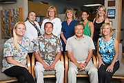 Owner Justin Cheng, DDS, left-center, Wesley Murakami, DDS, and their team pose for a portrait at Justin L Cheng & Wesley Murakami, DDS, in Fremont, California, on April 9, 2014 (Stan Olszewski/SOSKIphoto)