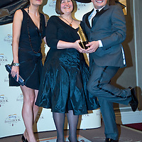 LONDON - APRIL 09: Author Kim Edwards (C) with her Popular Fiction award for 'The Memory Keeper's Daughter' with comedian Alan Carr and guest during the Galaxy British Book Awards held at the Grosvenor House Hotel on April 9, 2008 in London, England.