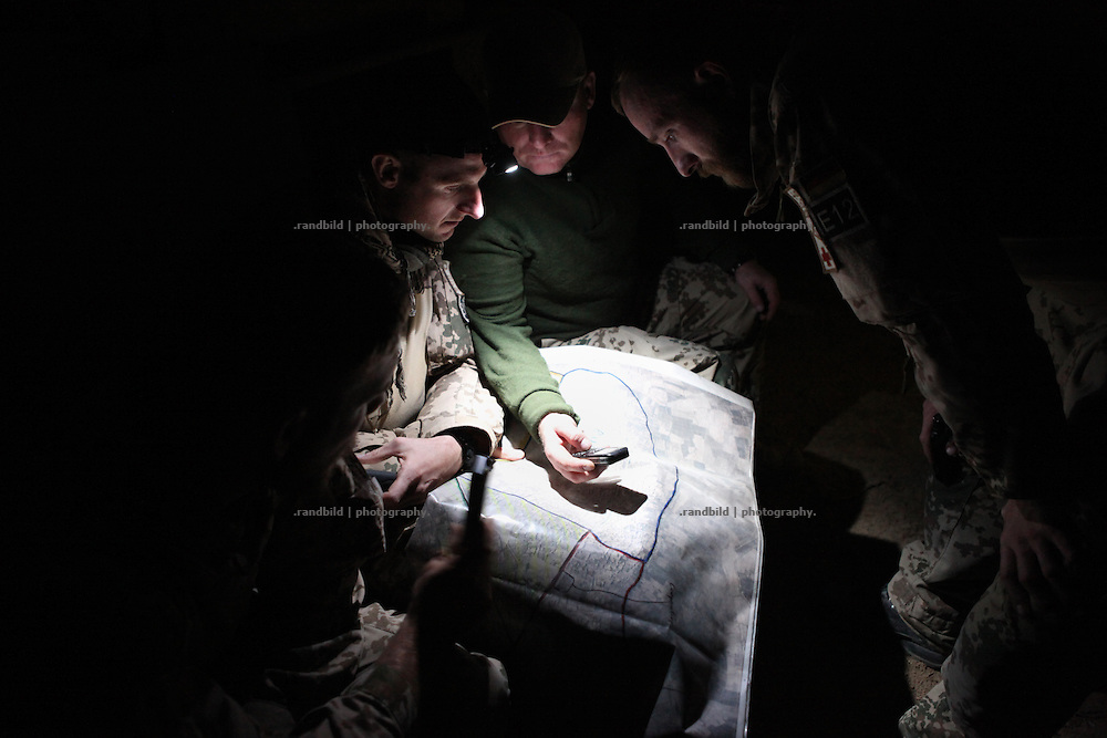A Sergeant checks a map in the dark with comrades. In late October 2011 Kunduz based 3.Task Force started a several days operation in and around Nawabad (District Chahar Darah), west of Kunduz, northern Afghanistan. During the Operation Orpheus about 100 german infantery soldiers rolled out for patrols through the town and surrounding areas, which were expected as a retreat zone of insurgents.