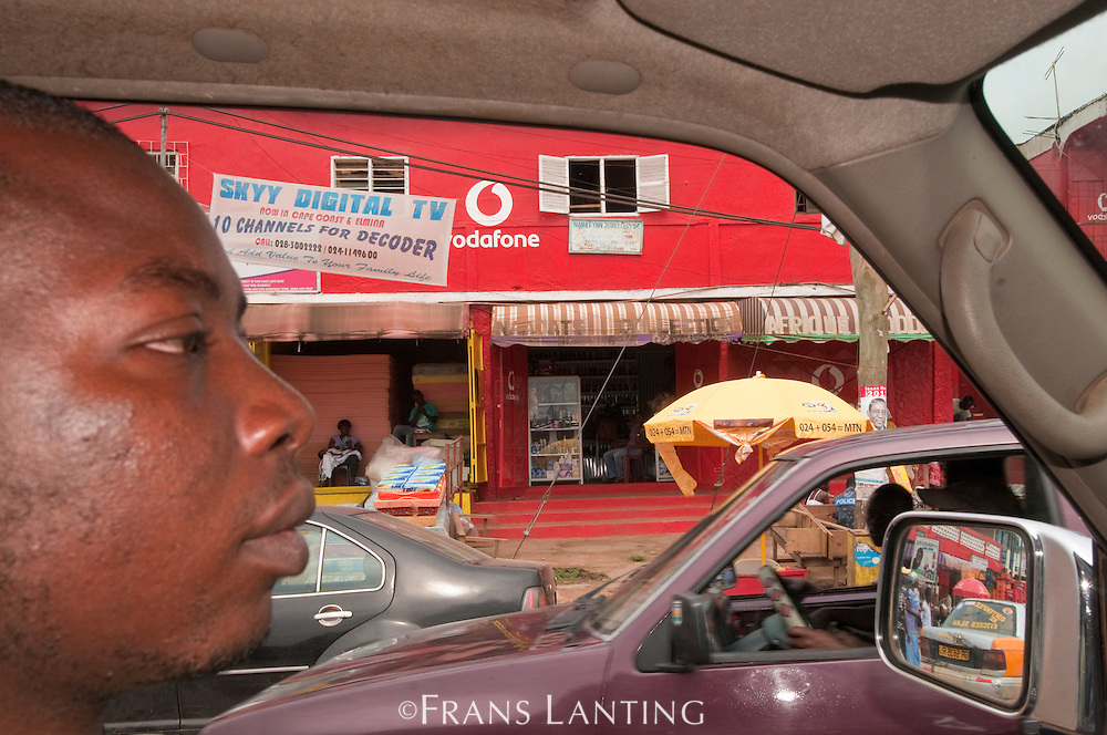 Driver in traffic, Elmina, Ghana