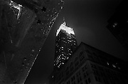 """Empire State Building at night, during rainstorm...Part of long-term (2005-2008) story """"I See A Darkness"""". New York, NY."""