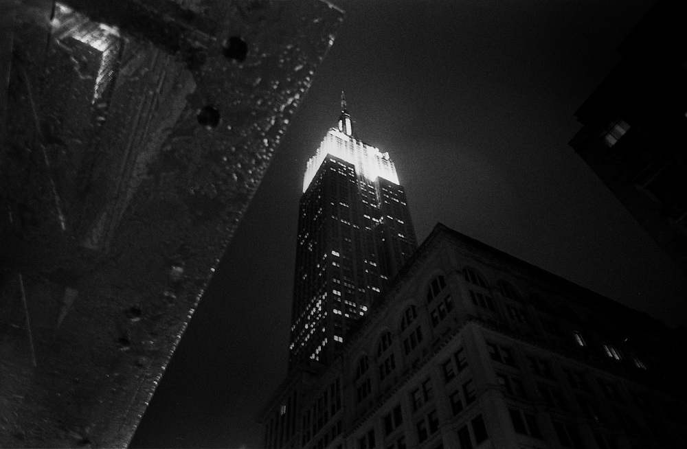"Empire State Building at night, during rainstorm...Part of long-term (2005-2008) story ""I See A Darkness"". New York, NY."