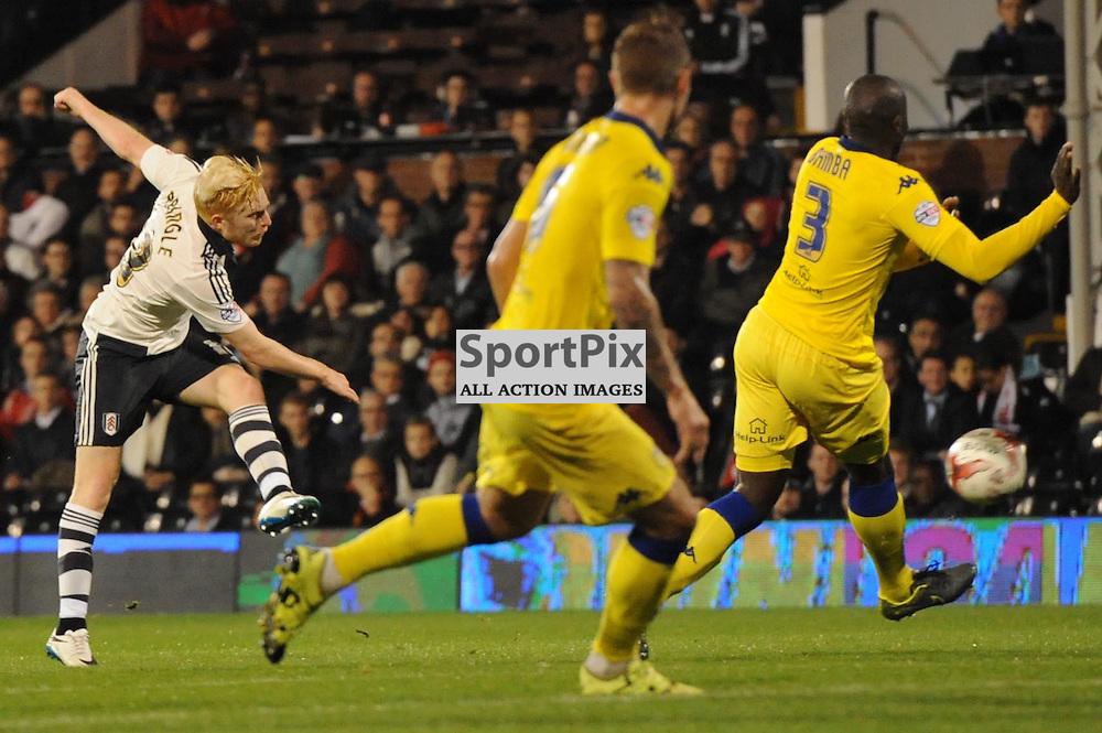 Fulhams Ben Pringle gets a shot away during Fulham v Leeds United game in the Sky Bet Championship at Craven Cottage on the 21st October 2015.