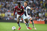 Aston Villa defender (on loan from Manchester United) Axel Tuanzebe (4) battles for possession  with West Bromwich Albion midfielder (on loan from Fulham) Stefan Johansen (6) during the EFL Sky Bet Championship play-off second leg match between West Bromwich Albion and Aston Villa at The Hawthorns, West Bromwich, England on 14 May 2019.