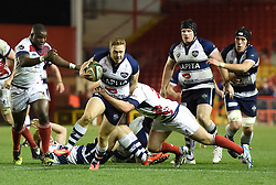 Bristol Rugby's replacement scrum half, Luke Baldwin is tackled - Photo mandatory by-line: Paul Knight/JMP - Mobile: 07966 386802 - 05/12/2014 - SPORT - Rugby - Bristol - Ashton Gate - Bristol Rugby v London Scottish - B&I Cup